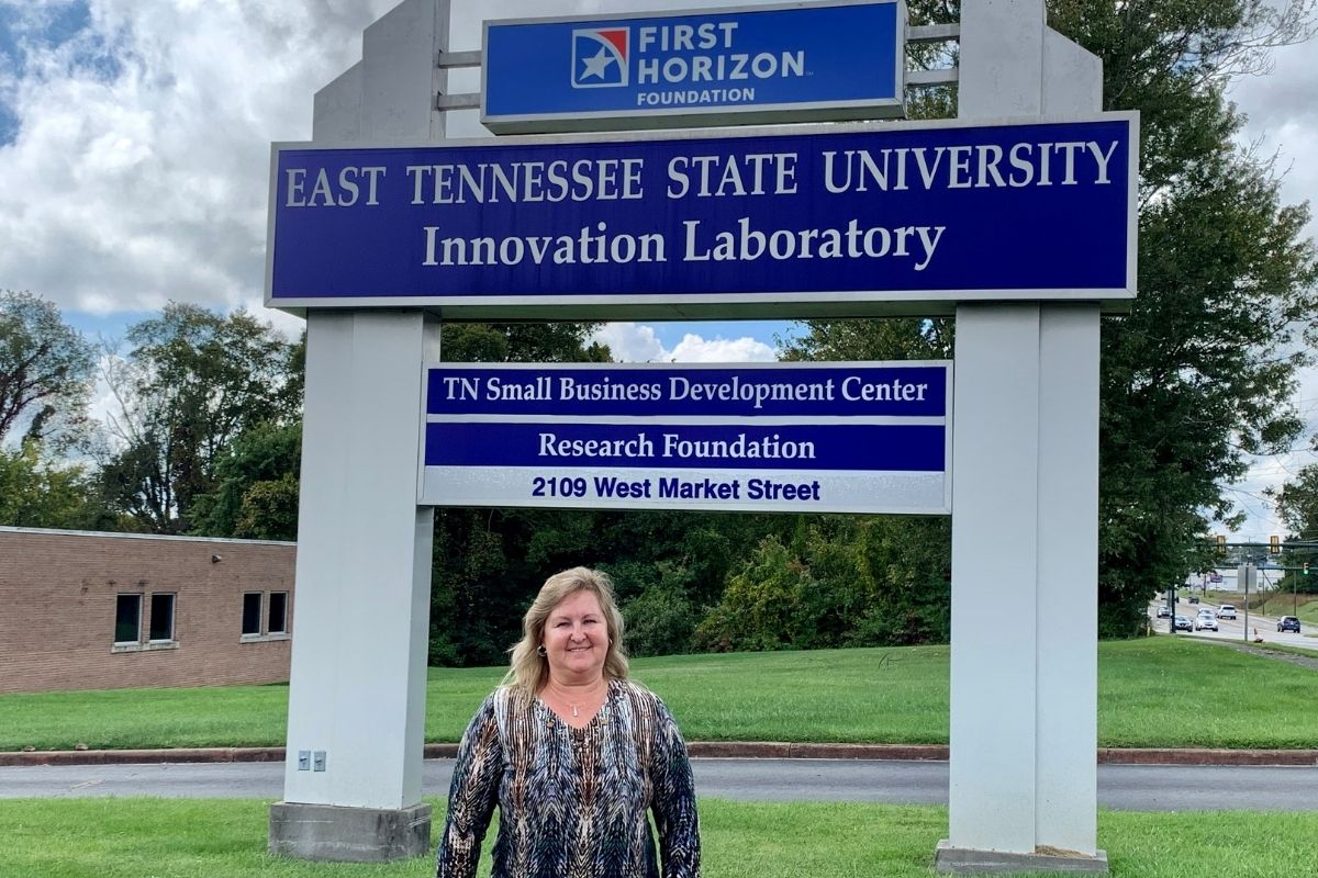 Debbie Smith of US Respiratory stands in front of the Innovation Lab sign.