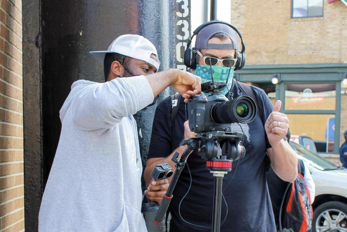 Two men setting up a video camera on a production shoot.